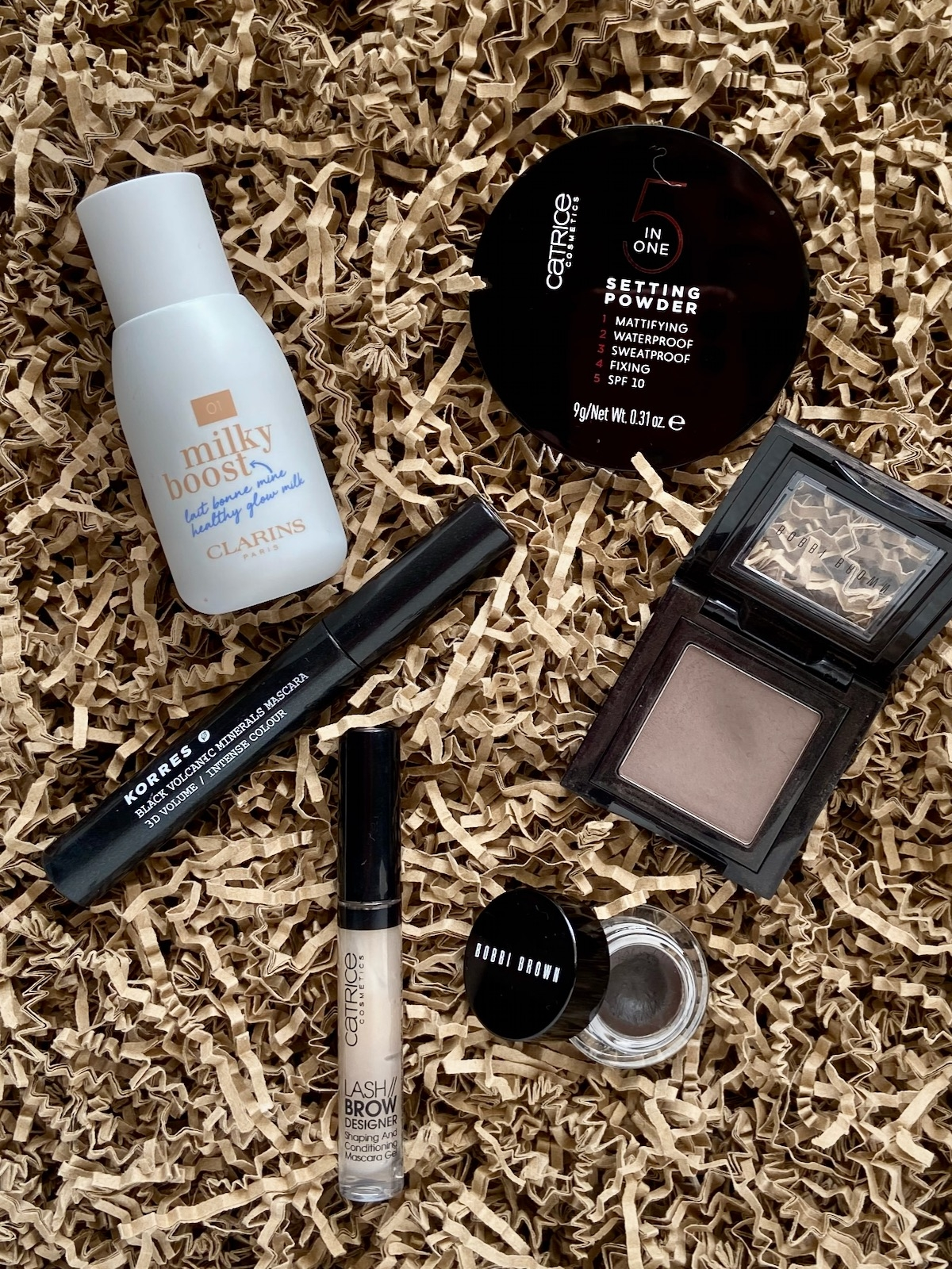 Clarins Milky Boost Catrice Setting powder 5 in One Korres Professional Volume Mascara Bobbi Brown Gel Eyeliner Espresso Bobbi Brown Eyeshadow Slate Ctarice Lash Brow Designer
